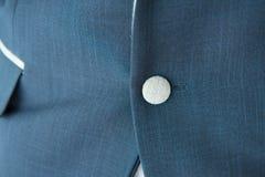 Botón del traje azul Imagen de archivo libre de regalías