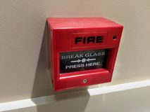 Botón la alarma de incendio Imagenes de archivo