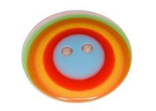 Botón multicolor para la ropa aislada Fotos de archivo