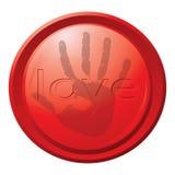 Botón rojo con una impresión de una mano Fotos de archivo libres de regalías