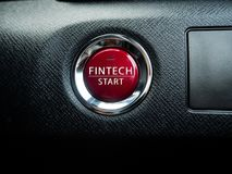Botón rojo grande de Fintech en el fondo negro Imagen de archivo libre de regalías