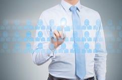 Botón social de la prensa del hombre de negocios medios Fotografía de archivo libre de regalías