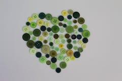 Botón verde del corazón Imagen de archivo libre de regalías