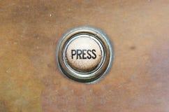 Botón viejo - prensa Imagenes de archivo