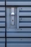 Botón y cerradura de acero de puerta Imagenes de archivo