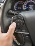 Botões audio do controle em um volante Imagens de Stock Royalty Free