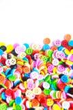 Botões coloridos, Clasper colorido no fundo branco Imagens de Stock Royalty Free