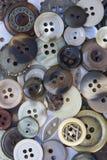 Botões de Brown, bege e verdes da costura Fotografia de Stock Royalty Free
