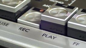 Botões do controle do registro das imprensas do dedo no jogador de cassete áudio video estoque