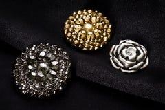 Botões do metal no pano preto Imagem de Stock
