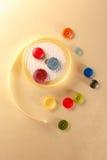 Botões e rolo coloridos da fita Fotos de Stock