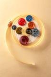 Botões e rolo coloridos da fita Imagem de Stock Royalty Free