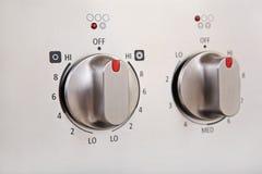 Botões em um fogão moderno do aço inoxidável Imagens de Stock Royalty Free
