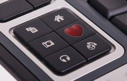 Botões em um teclado - amor Imagem de Stock Royalty Free