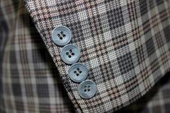 Botões em um terno Fotos de Stock Royalty Free