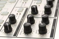 Botões em uma máquina de cilindro Fotos de Stock