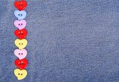 botões Multi-coloridos na forma dos corações Fotos de Stock Royalty Free