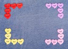botões Multi-coloridos na forma dos corações Foto de Stock Royalty Free
