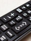 Botões no controlo a distância para a televisão Fotos de Stock Royalty Free