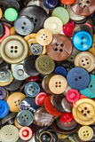 Botões para o fundo da roupa Imagens de Stock