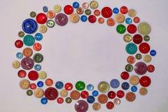 Botões para a roupa, mistura da cor Fotografia de Stock Royalty Free