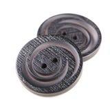 Botões pretos velhos isolados no fundo branco Fotografia de Stock
