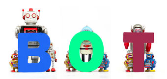 BOT robots. Vintage toy robots holding up the word BOT Royalty Free Stock Photography