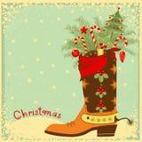 Bota de vaquero con los elementos de la Navidad Fotografía de archivo