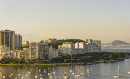 Botafogo beach and cove. Boats moored in Botafogo cove with buildings in the background Stock Photos