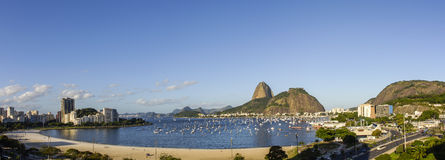 Botafogo beach and Sugar Loaf hill. Panoramic view of the beach and bay of Botafogo with its moored boats and the Sugar Loaf Mountain in the background Royalty Free Stock Images