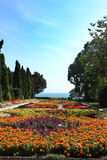 Botanic garden with flowers and sea Royalty Free Stock Images