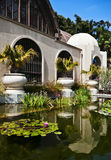 Botanical Building, Balboa Park. Botanical Building in Balboa Park, San Diego, California, which contains a botanical garden, is reflected into a reflecting pond stock image