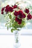 bouquet flowers in glass bottle. instagram toned. orange color, green vase, flora, bouqet of orange flowers, nature, botanical, be Royalty Free Stock Photos