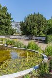 Botanical garden of Berlin with pond and greenhouse Stock Photo