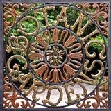 Botanical Garden gates in Singapore. July 2018: Botanical Gardens, Singapore - close up of wrought iron gate with ornate Botanic Gardens signage royalty free stock images