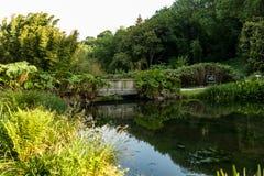 Botanical Garden Le Vallon du Stang Alar Brest France 27 may 2018 - small lake and bridge Summer season.  royalty free stock photo