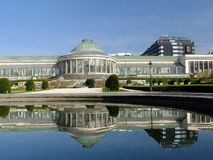 Botanical garden reflecting into water. Brussels: `Le botanique` Stock Photos