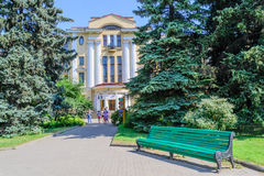 Botanical garden in St. Petersburg. The entrance to the Botanical garden. Beautiful green Park bench. Historic building in the Park. Botanical garden the Stock Image