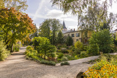 Botanical garden in Tartu, Estonia. Botanical garden with many plants and a building on background Royalty Free Stock Photos
