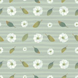 Botanical seamless pattern with white blooming flowers and leaves against green background with pale paint traces Royalty Free Stock Image