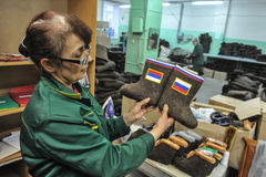 Botas com símbolos de estado do russo Imagem de Stock