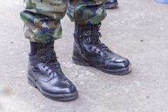 Botas de combate negras militares Imágenes de archivo libres de regalías