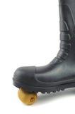 Botas de goma negras con el kiwi Imágenes de archivo libres de regalías