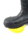 Botas de goma negras con el plátano Fotos de archivo libres de regalías