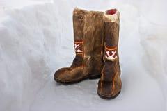 Botas de lã na neve Fotos de Stock