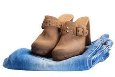 Botas de vaqueiro nas calças de brim Imagem de Stock