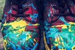 Botas del color en fondo de madera Imagen de archivo libre de regalías