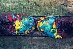 Botas del color en fondo de madera Imagen de archivo