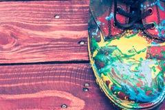 Botas del color en fondo de madera Foto de archivo libre de regalías