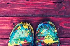 Botas del color en fondo de madera Fotografía de archivo